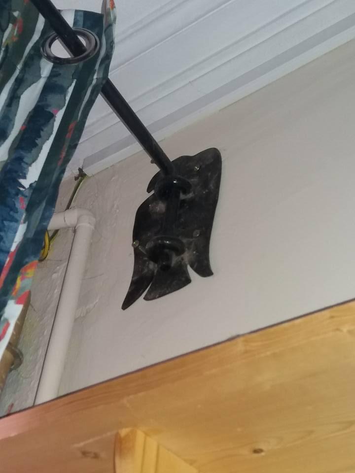 Swinging curtain rail by blacksmith Jasper Johns. I still have to tighten a couple of screws.